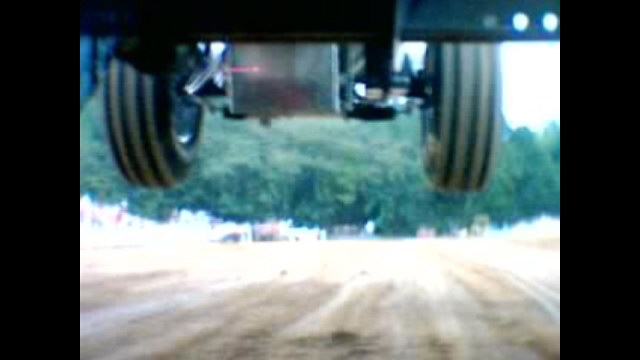 picture of under a pulling tractor marty chandler deeply hooked showing frame and chassis flex